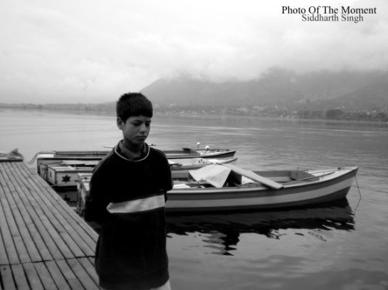 A Kashmiri boy with the Dal Lake (Srinagar) in the backdrop. Photo (c) Siddharth Singh